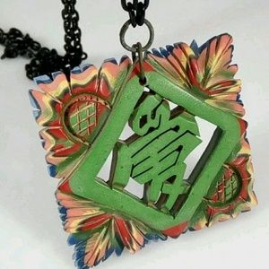 rare laminated necklace carved